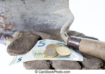 minimum wage - Brick trowel with work gloves and eight euro...