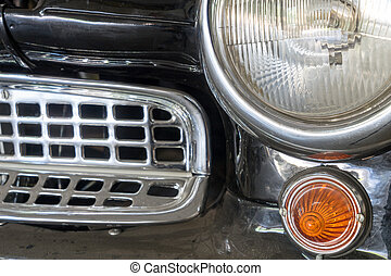 Oldtimer - very old car with chrome front grille