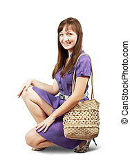 girl with handbag - young girl with handbag sitting on white...