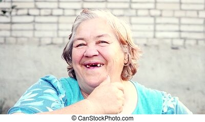 Portrait of 50 years old overweight woman smiling has...