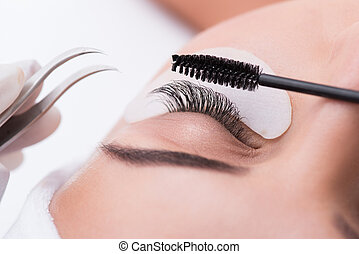 Lash lengthening treatment at beauty salon - Close up of...