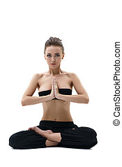 Yoga. Beautiful girl sitting in lotus position