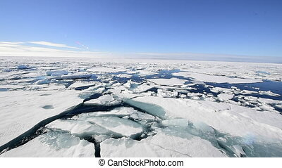 Sails through the sea ice in the Arctic - the ship sails...
