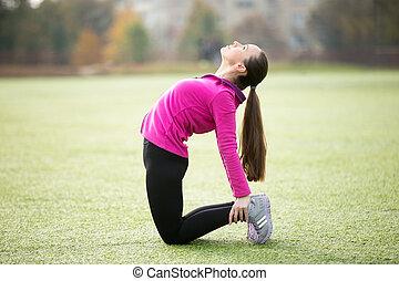 Yoga outdoors: Ushtrasana pose - Sporty beautiful smiling...