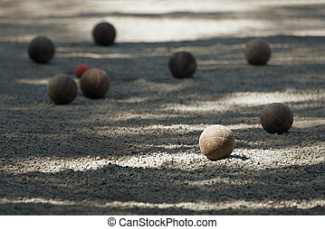 Petanque ball boules bawls on a dust floor