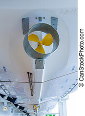 Hulls on Lifeboats - Yellow propeller on white hull of a...