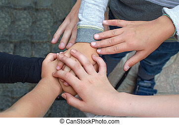 Childrens hands in a circle - A hands a group of children