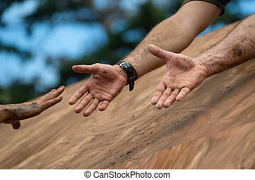 Mud race runners - Giving a helping hand,help when...