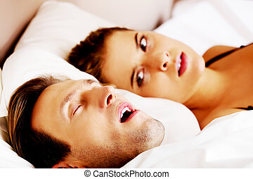Woman can't sleep becouse her snoring husband.