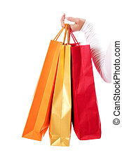Isolated womans hand carries a shopping bag. - Isolated...