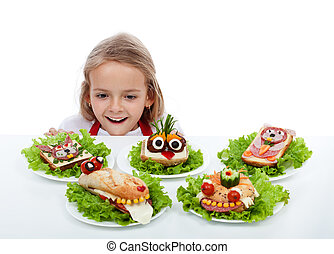 Happy child finds the sandwiches - Happy child in awe...