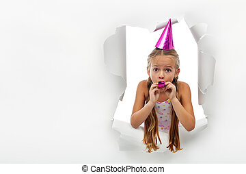 Surprise - little girl with party horn popping out from a...