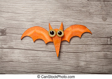 Flying Halloween bat made of carrot on board