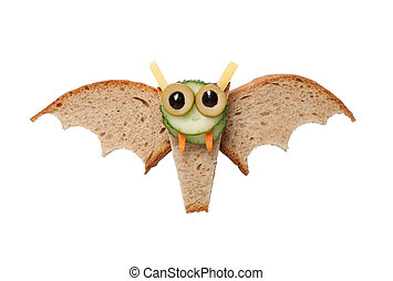 Halloween bat made of bread on white background