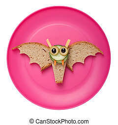Halloween bat made of bread on plate