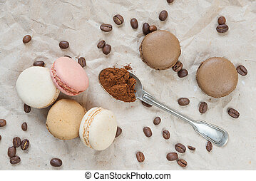 Multicoloured macaroons and coffee - Multicoloured...