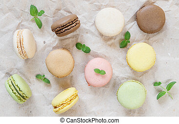 Multicoloured macaroons and mint leaves - Multicoloured...