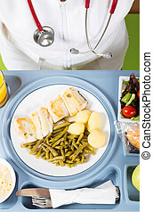Meal tray of a hospital - Health professional with a tray of...