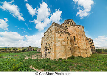 XII century church under a blue sky in Sardinia, Italy