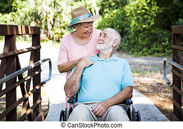 Senior Couple - Caretaker - Senior woman caring for her...