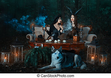 Girls witch in the woods conjure.