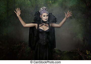 Girl scared in the woods with his hands - Gothic girl raised...