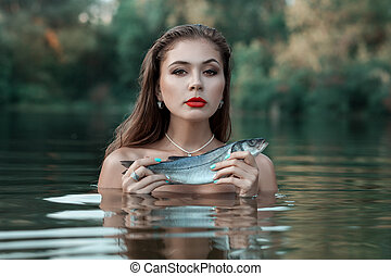 Portrait of a girl with fish.