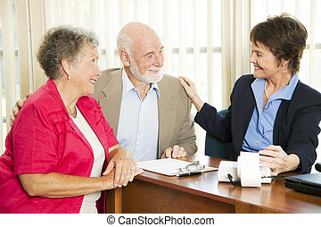 Seniors with Accountant - Senior couple gets good news from...