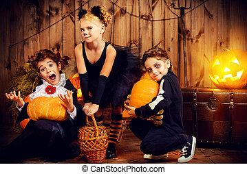 horror stories - Group of joyful children in halloween...