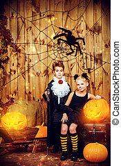 black cat and a vampire - Two funny children in halloween...