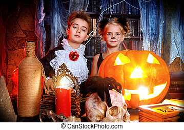 pumpkin burning eyes - Two cute children dressed as a...