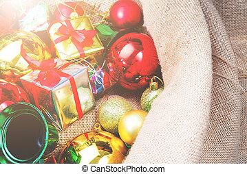 Christmas balls and gift box decorations in santa claus bag,...