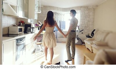 Husband leads his wife in their new home, young couple...