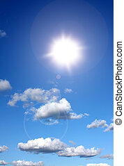 Sunshine in blue sky - Sun shining in blue sky with some...