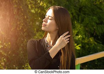 Young woman enjoying sunlight - Young beautiful woman with...