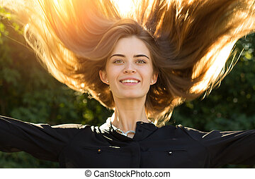 Woman throwing up her long hair - Young beautiful woman in...