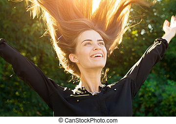 Woman throwing up her long hair - Young pretty woman in...