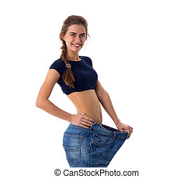Woman wearing jeans of much bigger size - Positive young...