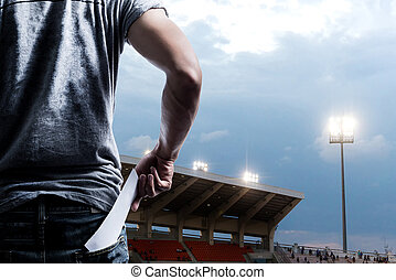 Fans presenting tickets or admission passes watch a soccer at stadium game