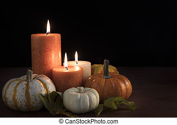 Autumn Candle Still Life - Three candles surrounded by...