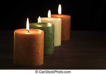 Four Autumn Candles - Row of autumn color burning candles...