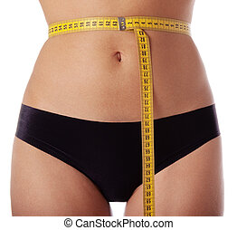 Measuring tape on female waist isolated on white