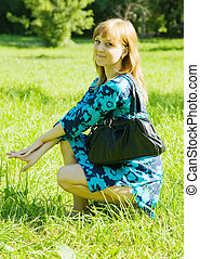 girl with handbag - Pretty girl with handbag sitting in...