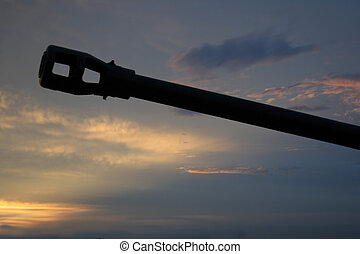 gun barrel against the sunset