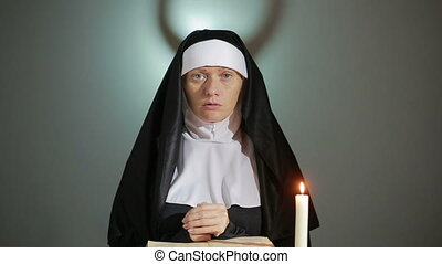 Halloween. nun prays. shadows in the form of devil. exorcism...