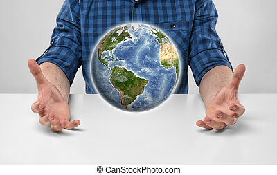 Cropped portrait of a man holding Earth in his hands.