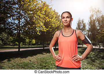 Smiling girl preparing for outdoors morning exercises - Stay...