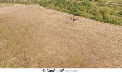 Drone copter UAV - aerial video shooting flying on eight...