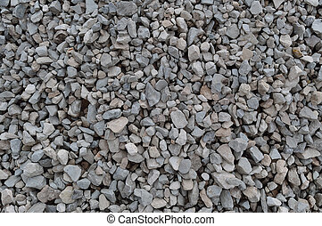 Abstract grey and beige gravel stone background, crushed gray stones and granite pieces texture, large detailed horizontal textured rough construction rock material mix pattern
