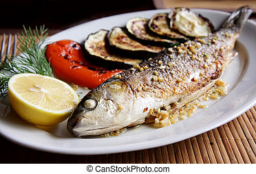 Grilled fish mullet on plate Shallow DOF